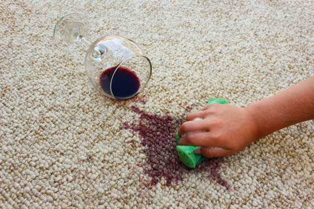 glass-red-wine-fell-carpet-wine-spilled-carpet-female-hand-cleans-carpet-with-sponge-detergent_104376-728