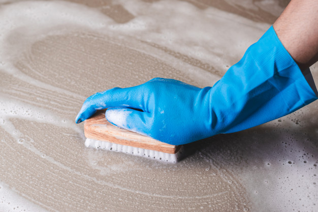 hand-man-wearing-blue-rubber-gloves-is-used-convert-scrub-cleaning-tile-floor_47469-582