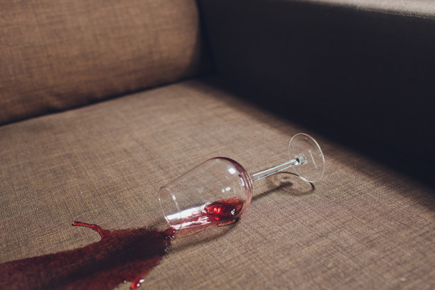 red-wine-spilled-grey-couch-sofa_152904-1704