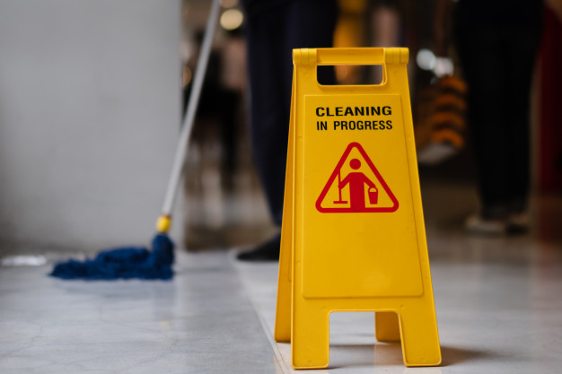 sign-showing-warning-caution-wet-floor-airport_21483-125
